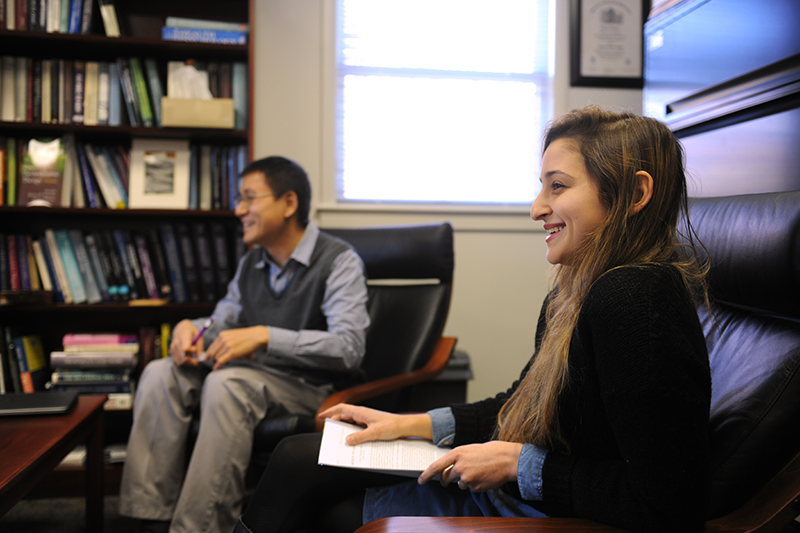 Adelphi doctoral students smile in class