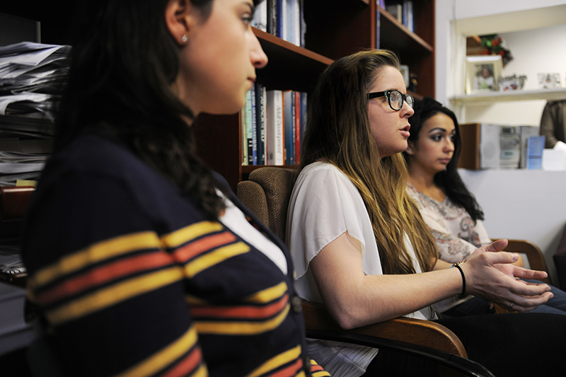 Adelphi psychology student explains point in classroom discussion