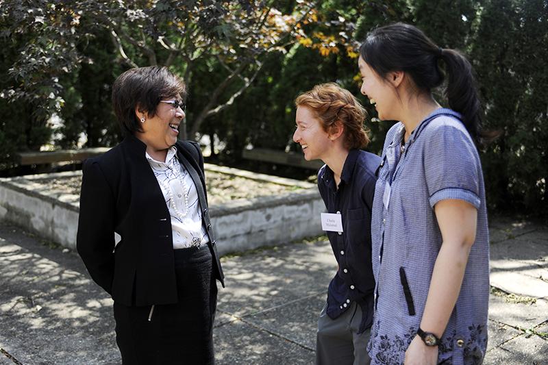 Derner psychology students laugh with professor at Adelphi