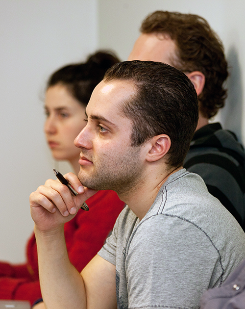Adelphi psychology students listen in class